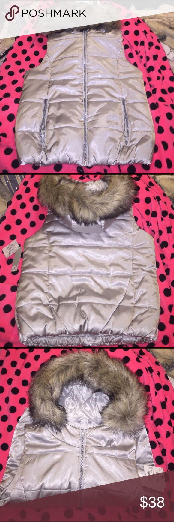 Liz Claiborne silver zip puff vest with fur hood Size large women's puffer zip up vest, silver with faux fur around the hood, zip pockets on each side, brand new with the tags, very very nice, extremely soft like silk,🚬🐱🏡💖I will accept reasonable offers💖 Liz Claiborne Jackets & Coats Puffers