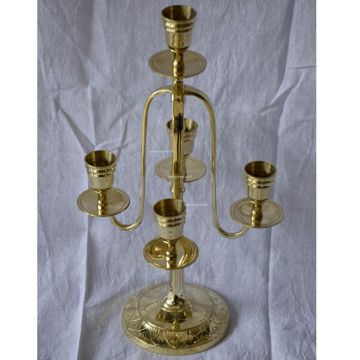 Traditional 5-piece brass candle-holder to add grandeur to any occasion
