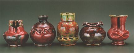 George Ohr -- Five red vases made between 1895-1910.He was called the mad potter of Biloxi MS