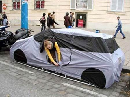 Unusual car tent designed to look like a car cover, so you can go camping in the city without being disturbed.