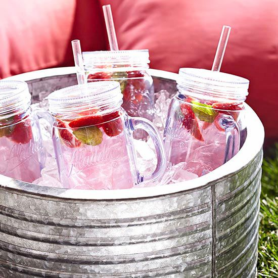 Fun Serving Ideas for a 4th of July Picnic...Mason Jar Drinks with straws and handles!  Add red white and blue fruit to make it more festive!