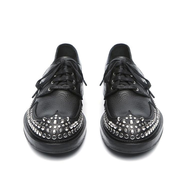 Pebbled leather lace up shoe with iconic metallic studs from McQ by Alexander McQueen. A round toe, lace up closure. Leather lining. Iconic design lace up shoe decorative gothic elements.  Item Code: 468135  Materials: leather, rubber, metal  Made in Italy