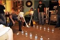 Head Bang Game: What you need: Pantihose, Balls, 16-20 small water bottels.  How to play:  Line two rows of bottels up. Divide the group into two teams. One member of