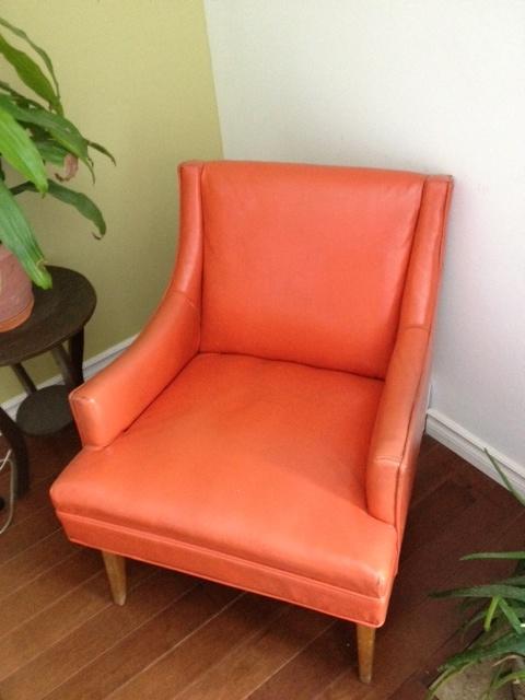 Beautiful orange chair 1950's decor
