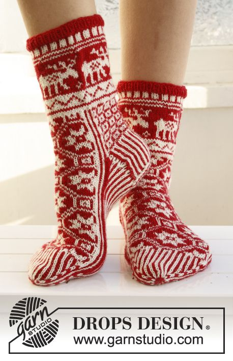 "Knitted DROPS Christmas socks with pattern in ""Fabel"". ~ DROPS Design"