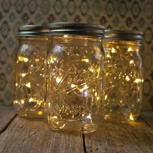 DIY :: Mason Jar Fairy Lights :: Run a small strand of battery-operated fairy lights (available very inexpensively on eBay) into the jar & tape (or use that sticky putty stuff) the battery pack to the inside of the lid. (However, you can buy this set of 3 x 16 oz jars for $18.94 @ lightsforalloccassions.com if you don't want to DIY.)