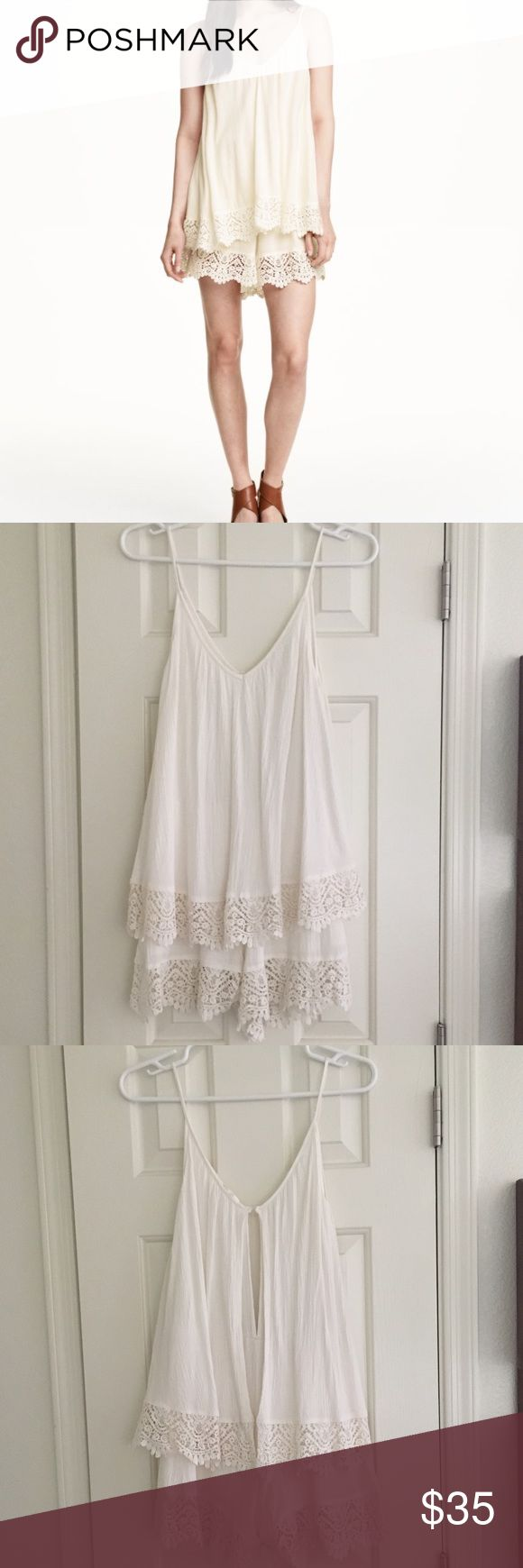 H&M Beige Playsuit in Lace | Cream | 6 This is in perfect condition and comes from a smoke free home! Description: Sleeveless jumpsuit in woven, crêped fabric with lace details. V-neck at front and back, narrow shoulder straps, elasticized seam at waist, and short, wide-cut legs. Opening at back with button at back of neck. Lace trim at hems and at hem of top section. 100% rayon. Color: Natural white H&M Other