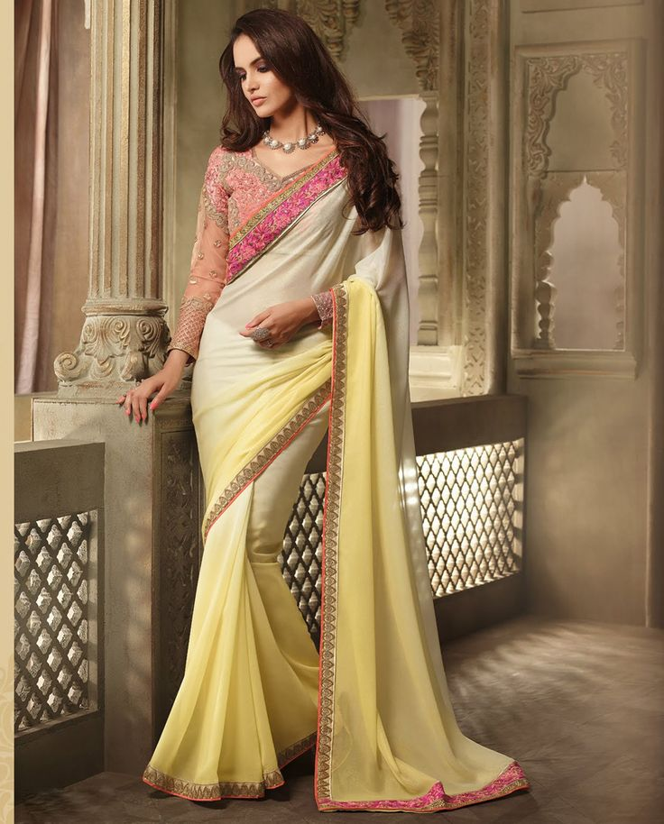 1. Yellow ombrey georgette shaded sari 2. Adorned with hand embroidered sari and thread work border 3. Matching heavy thread work and stone embroidered blouse 4. Comes with semi stitched matching blouse