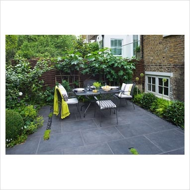 Table set for lunch on slate patio. London