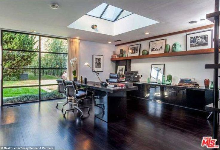 Peaceful: The study, with its domed skylight and pristine dark oak wood floors, offers a s...