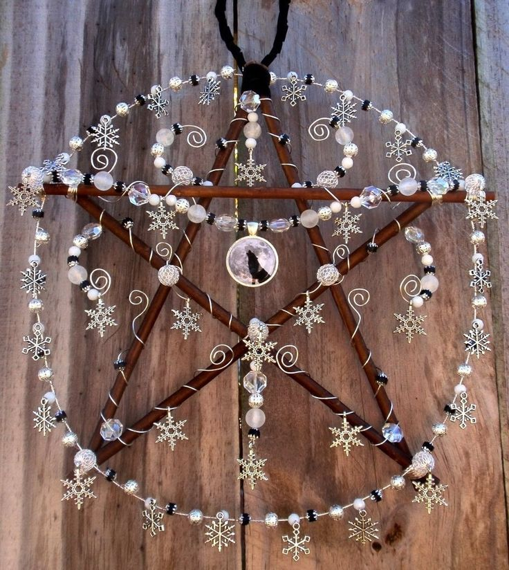 Winter Solstice Pentacle called Winter Wolf. Willow branches, wire, glass beads, crystal beads, silver snowflakes, and wolf pendant.