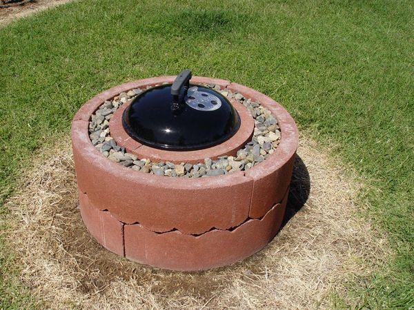 Homemade fire pit using brick tree rings, some gravel and a Weber Smokey Joe BBQ...genius!