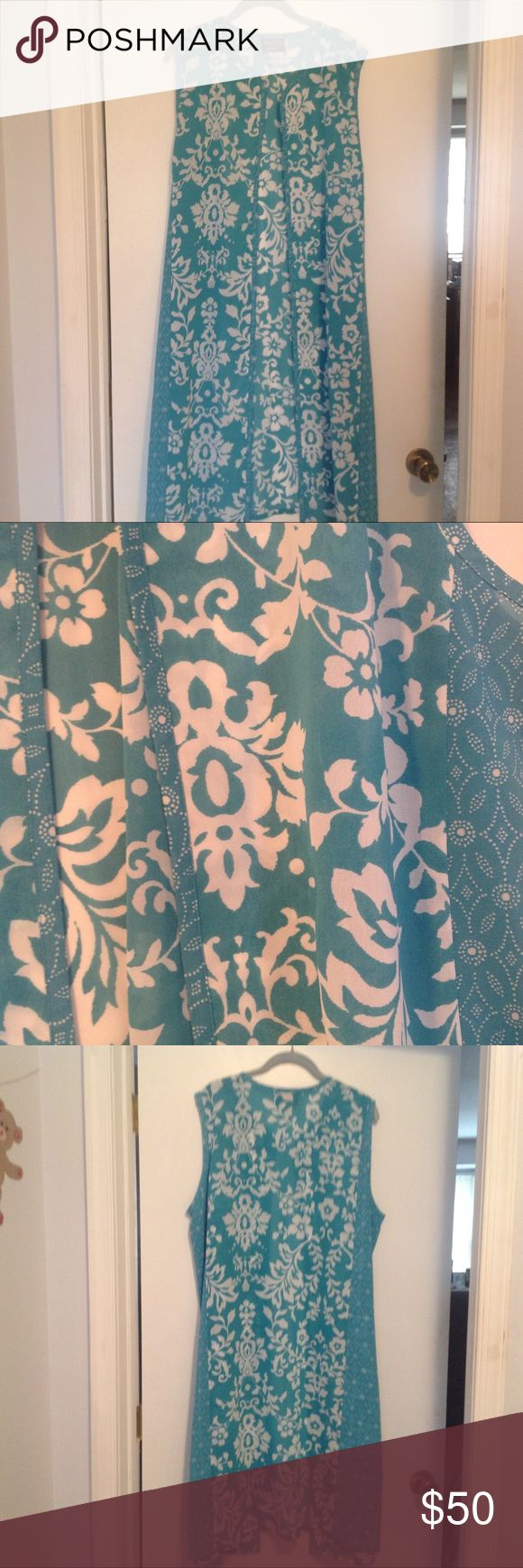 "Turquoise Duster or Cover- up1X NEW, 48"" long Beautiful turquoise and white long 42"" Duster or cover-up. NEW, never worn. 1X, 26"" flat bust, 12"" split side. 100 % polyester, machine wash. Tropical floral design, open front, no fastener, sleeveless. Swim Coverups"
