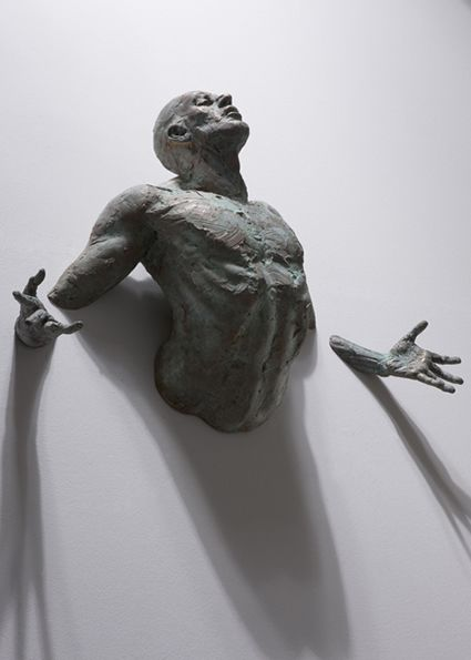 "A bronze sculpture by artist Matteo Pugliese called ""La Promessa"" (""The Promise"").  A fascinating contemporary artist who uses a classically-influenced figural style in a new and interesting way--the walls themselves become part of the work and influence the way in which we interpret his figures.  How do you interpret this one?"