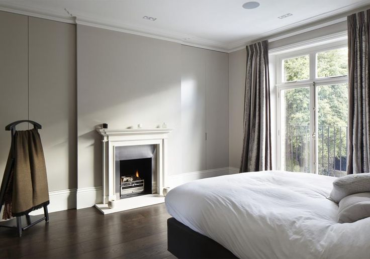 Montague Street | Richmond This period home was refurbished and classic interiors were added to compliment the period fireplace and corniced, while also introducing clever hidden wardrobes and storage.