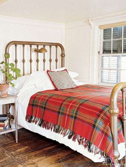 Classic tartan throw on bed