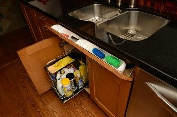 kitchen sink with tilting drawer face to reveal under-sink storage. Pull-out racks under sink as well.