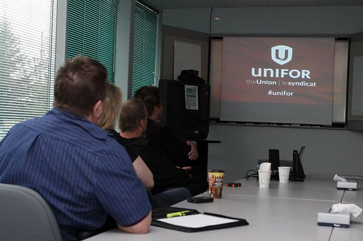 Local union members watch unveiling of the new Unifor logo on May 30, 2013.  #tbay