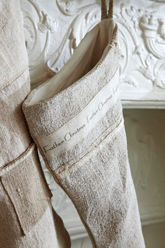 Quietly pretty holiday stockings are custom-made from vintage French linen. Love! - Traditional Home ®