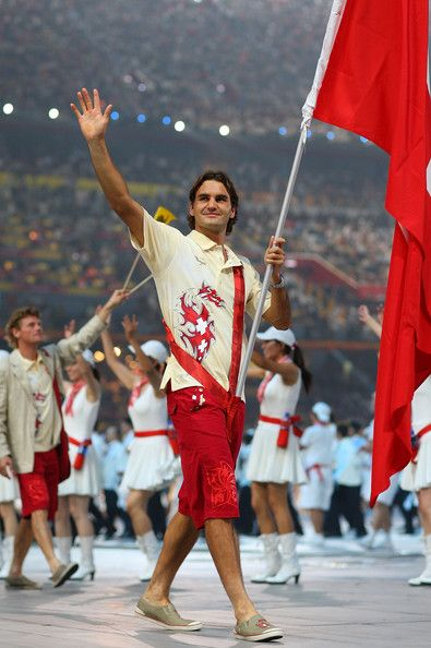 Roger Federer of the Switzerland Olympic men's tennis team carries his country's flag to lead out the delegation during the Opening Ceremony for the 2008 Beijing Summer Olympics at the National Stadium on August 8, 2008 in Beijing, China.