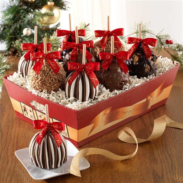 Days of Christmas Petite Apple 8-Pack | Ladies will be dancing and Lords will be leaping with the first bite of a Mrs. Prindable's caramel apple. The spirit of a holiday favorite adorn a festive red tray filled with 8 petite apples: two Triple Chocolate, two Milk Chocolate Toffee Walnut, two Milk Chocolate Walnut and two Dark Chocolate Cashew. 10 Pack also available