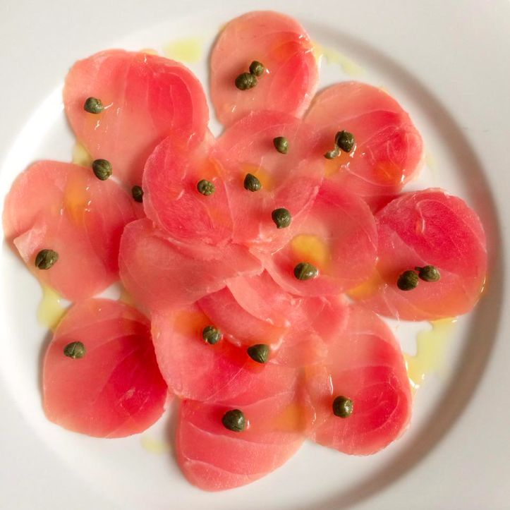 Tuna Capaccio with capers and truffle oil