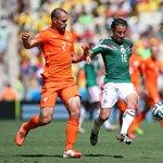 Andres Guardado of Mexico controls the ball against Ron Vlaar of the Netherlands