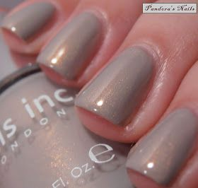 Covent Garden Ballet - nails inc. A light grey polish with a gold shimmer running through it.