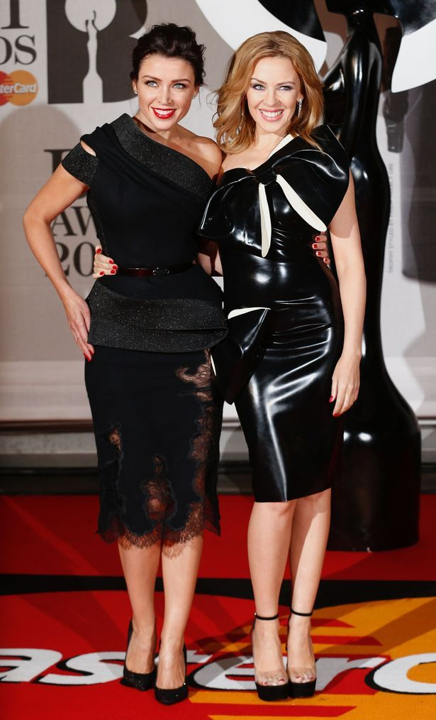 Dannii and Kylie Minogue posing at the BRITs last year