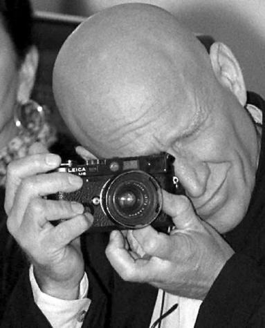 "Sebastião Salgado with a Leica M6 | ""Brazilian social documentary photographer and photojournalist."" 