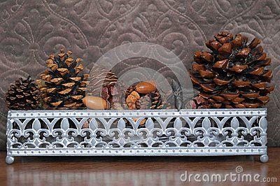 Christmas arrangement - Basket with fir cones, cones enupar and acornn