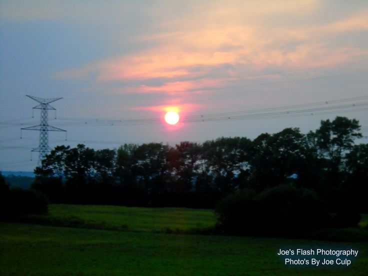 Evening Sunset on a Humid July evening off Highway 62 over Thurlow Ward near Foxboro Ontario