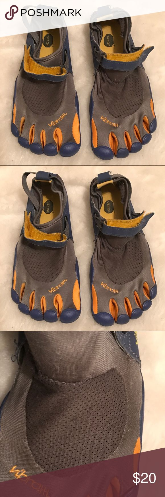 Vibram five finger shoes- Sz 40 Vibram five finger shoes size 40 (refer to size chart in pictures). Colors are gray blue and gold. Shoes are in fair condition some unraveling on fabric, soles are in good condition. Vibram Shoes
