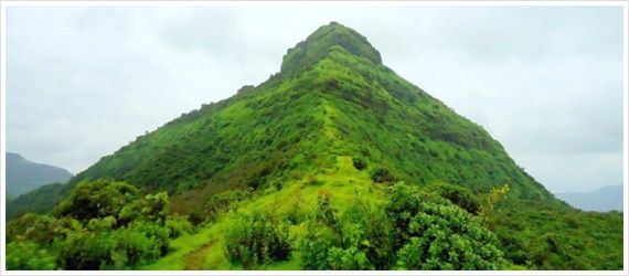 Monsoon Trek to Tikona Fort >> The fort is a #trekking destination noted for the large doors, the temple of 'Trimbakeshwar Mahadev', a water tank and some Satvahan caves.  #MonsoonTrek  #TikonaFort
