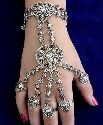 Intricate bracelet/rings.