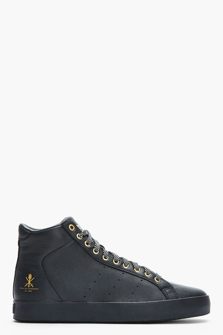 adidas Originals By O.C. Black And Gold Leather Rod Laver Vintage Mid-tops for men | SSENSE