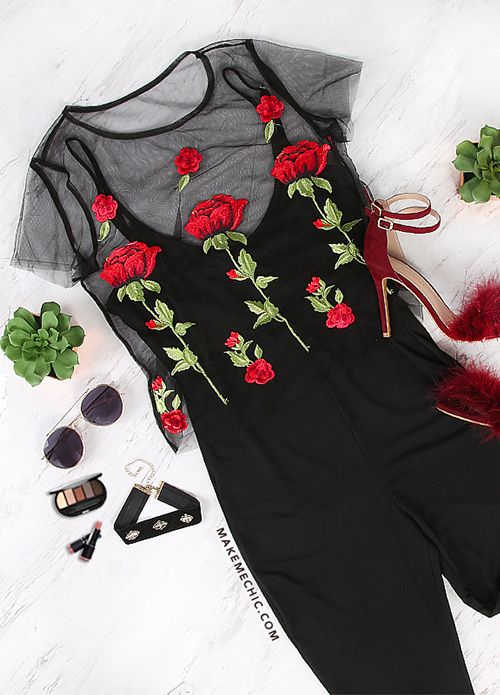 "Enchant in the Rose Bud Mesh Top. Features sultry mesh material, a round neckline, short sleeve arms, a raw cut hemline and gorgeously embroidered floral-rose patches. Top measures 19.6"" in. from top to bottom hem. Complete the look with a black satin bralette, black denim skinnies and a deep red lippie."