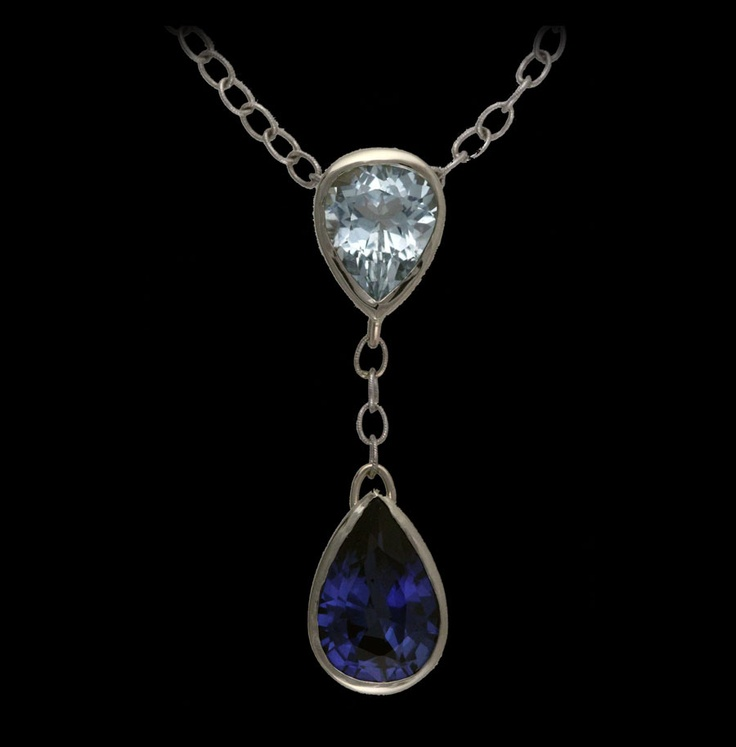 5.5ct pear shaped sapphire and 2.7ct pear shaped aquamarine bezel set in 14k white gold.