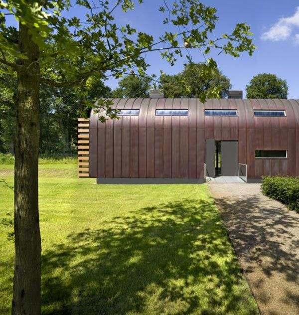 Metal Roof Houses curved steel roof home by Dutch architects