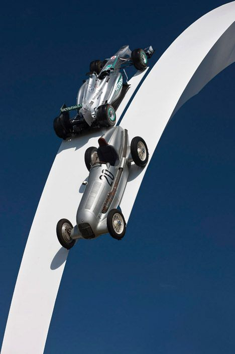Gerry Judah's arcing sculpture suspends Mercedes cars above Goodwood crowds.