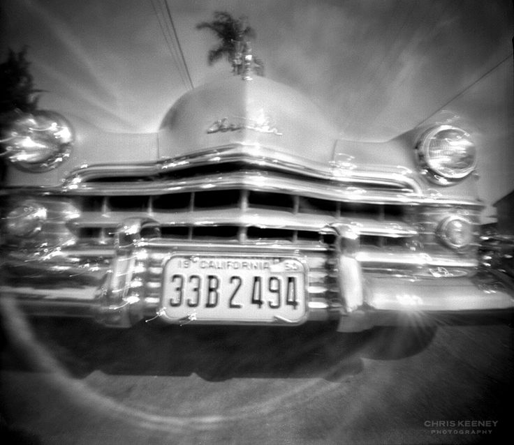 Chris Keeney. 6x6 black and white PinHolga pinhole photography of vintage Chrysler California car. Ilford Delta 400 medium format 120 film. 3 second exposure