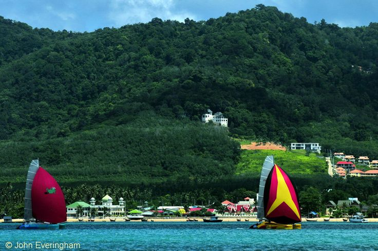 Chalong Bay, Phuket.  The opposite view, from a boat to Chalong's shore, shows a large mosque and modern housing estates.
