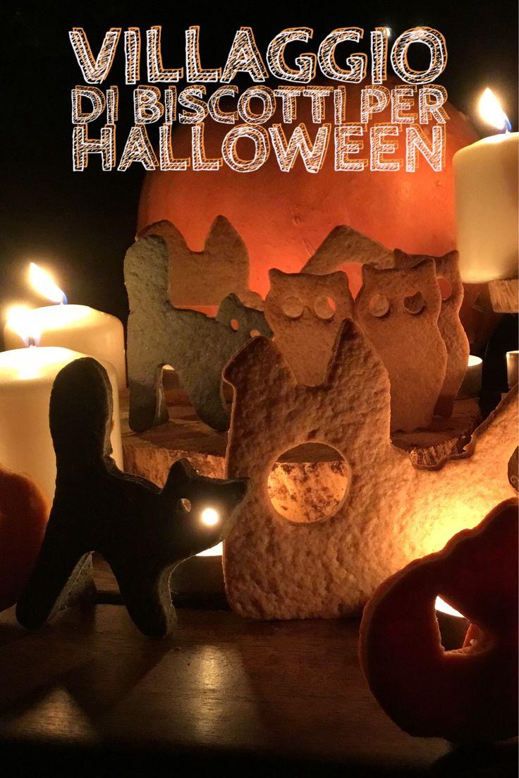 Uno Scenografico Villaggio di Halloween, con Gufi, Gatti e Zucche