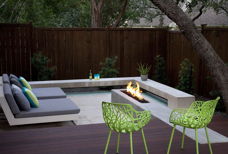 concrete fire pit in a sunken lueders limestone patio with a floating concrete bench. Like the idea of neutral/ green garden but interjecting some colour with cushions and furniture