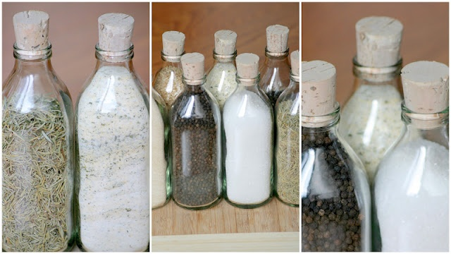 Re-used glass bottles + corks = our DIY spice rack! Also an easy way to organize your pantry!