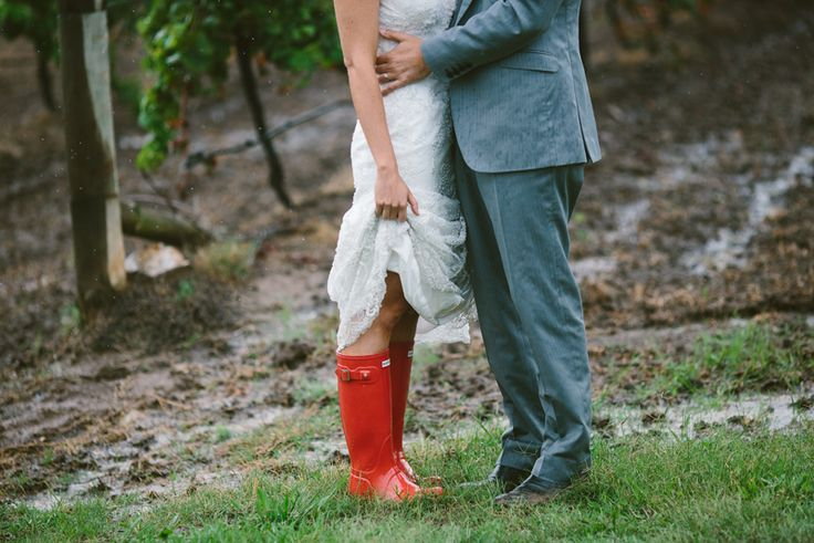 Fabulous red Hunter boots wedding shoes for a rainy wedding day. Image: Cavanagh Photography http://cavanaghphotography.com.au