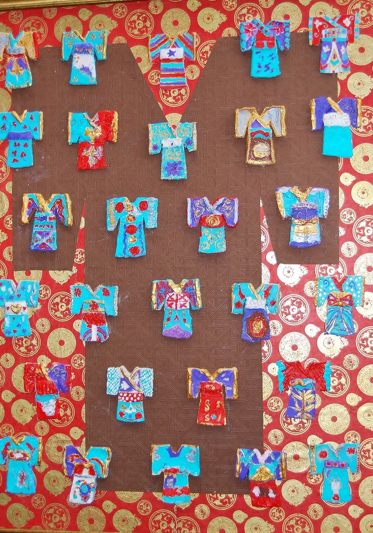 Clay kimonos on decorative Asian themed art papers. The photo doesn't even do it justice. This was an amazing project! 4th Grade