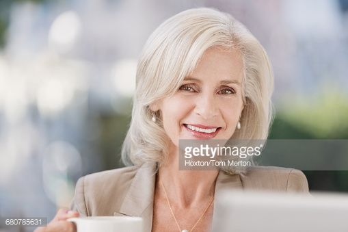 Stock Photo : Portrait smiling senior businesswoman drinking coffee