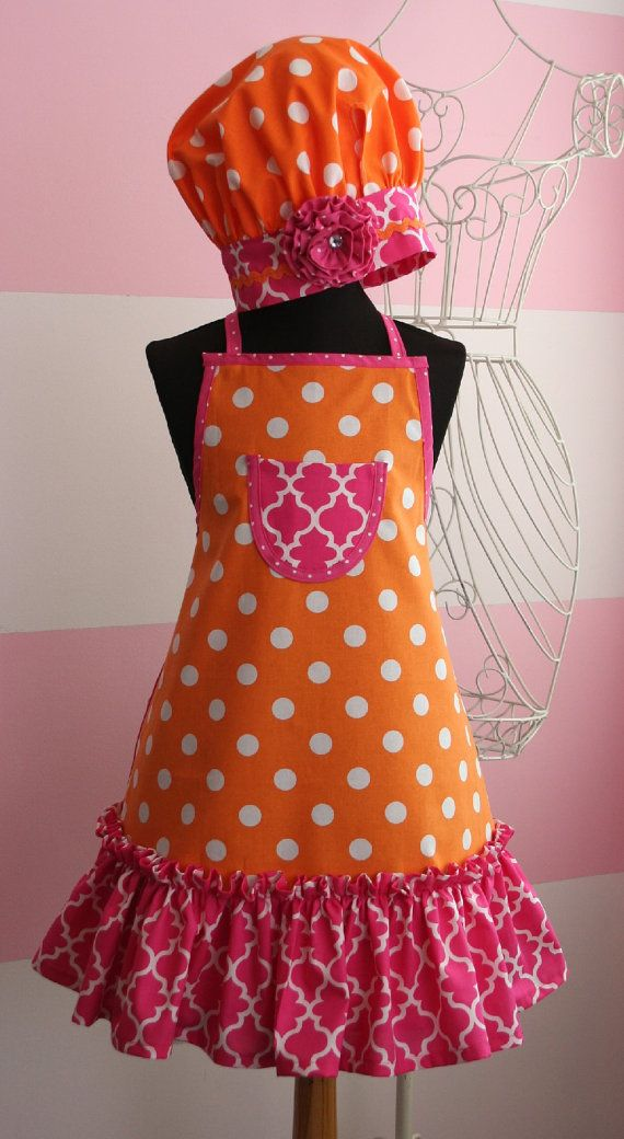 Your little girl will love to help out in the kitchen when she is dressed in this adorable apron set. It features a pretty ruffled skirt and small