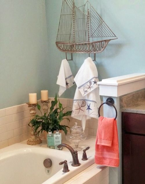 Coastal Bathroom With A Large Sailboat Hook Towel Rack